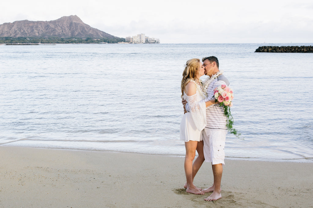 Bride and Groom Kiss on Duke Kohanamoku Beach in Waikiki, Oahu, Hawaii