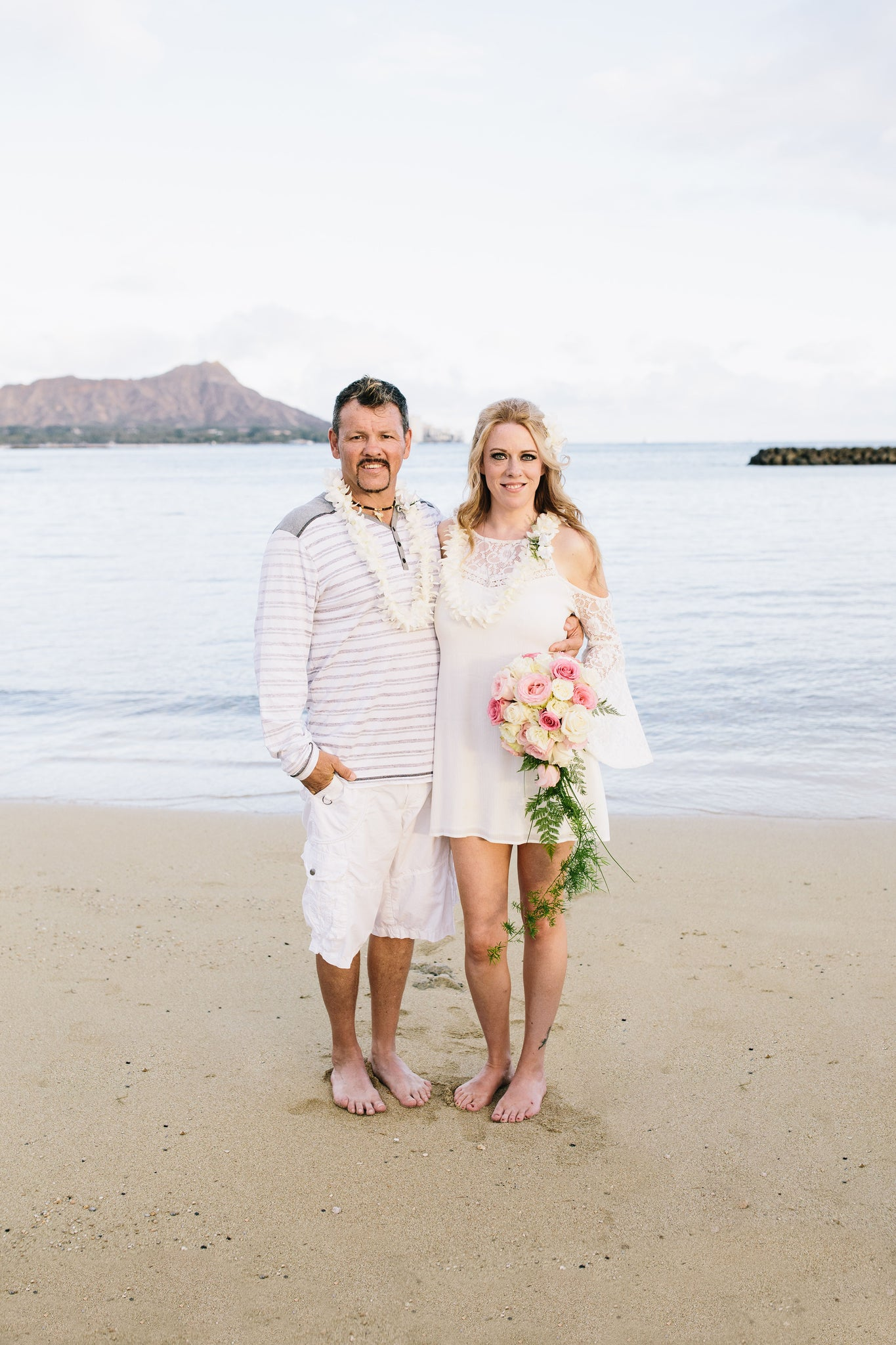 Bride and Groom Marry on Duke Kohanamoku Beach in Waikiki, Oahu, Hawaii