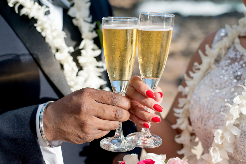 Couple enjoy a Sparkling Cider Toast in Maui, Hawaii