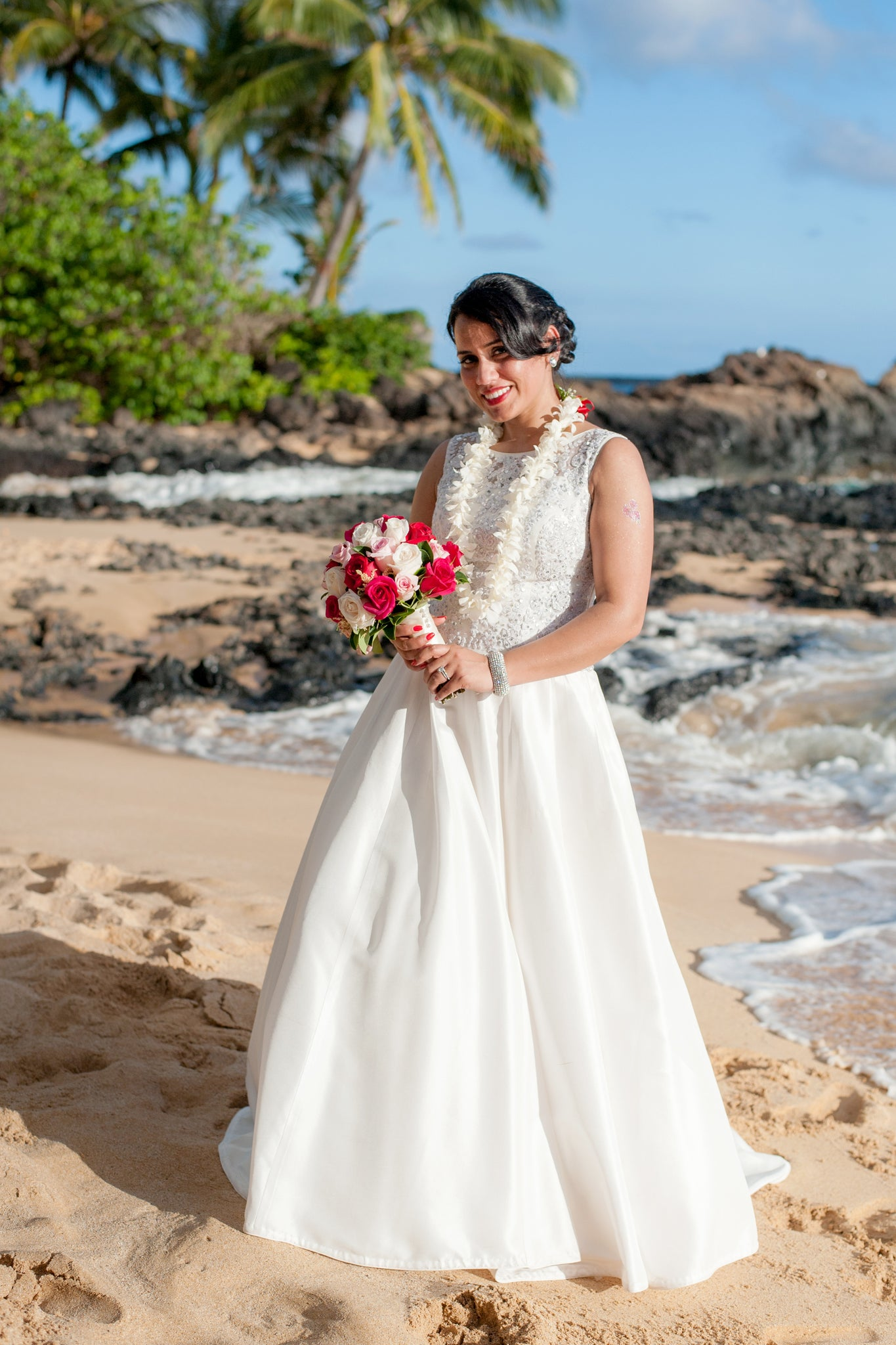 Bride poses on a beach in Maui, Hawaii