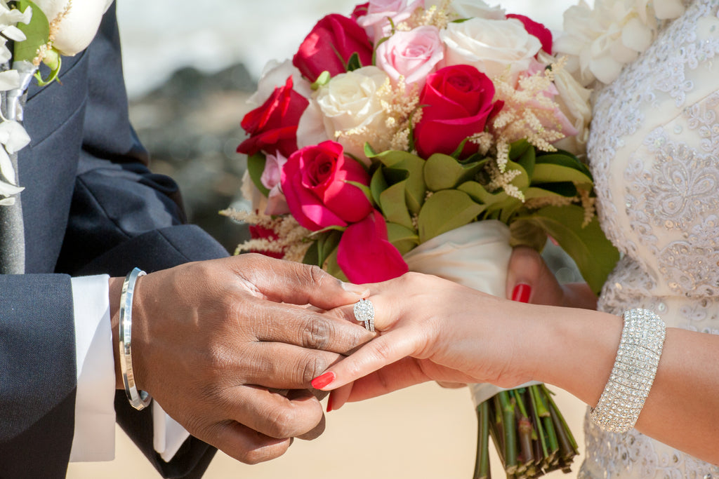 Groom places Wedding Ring on Bride in Maui, Hawaii