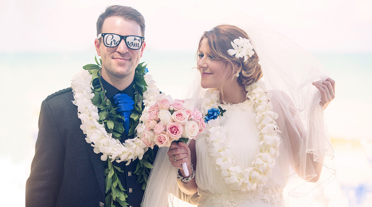 A Bride and Groom laugh and joke in Maui