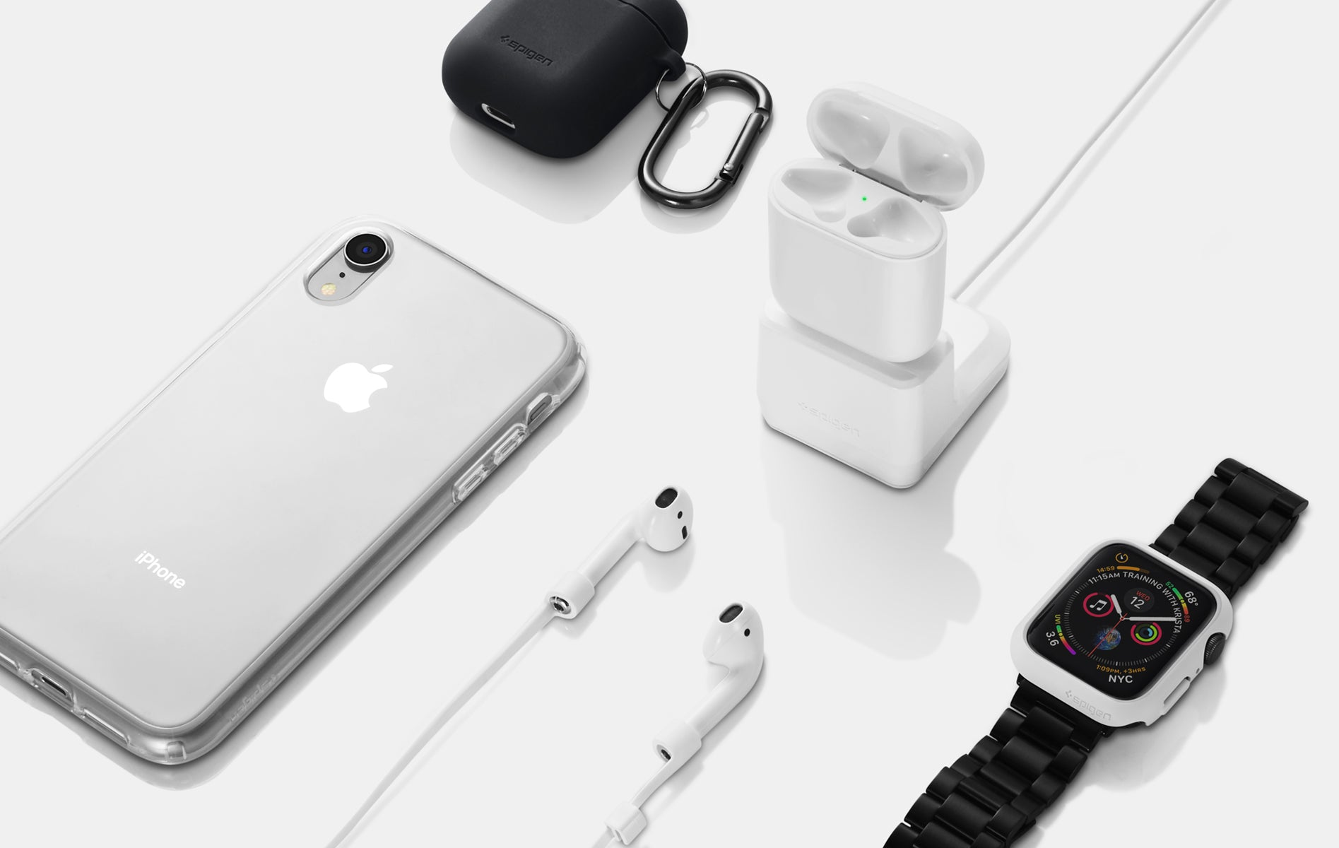 A collection of Airpods Silicone Black case, Airpods charger, iPhone in clear case, Airpods with a strap, and an Apple watch with black band.