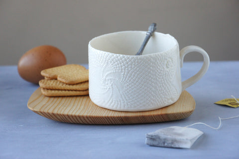 handmade porcelain mug, with white lace design