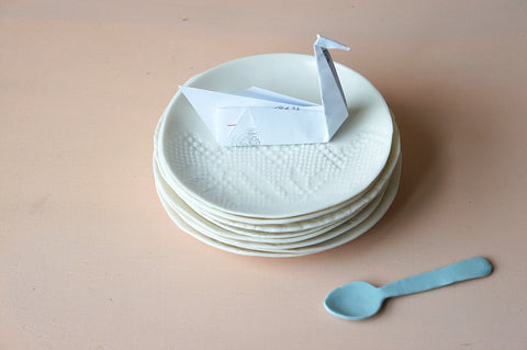 handmade porcelain tea plate, textured with lace design, white colour. Match with our espresso cups.