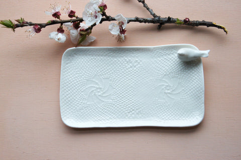 handmade porcelain tray, perfect to serve small cakes or espresso for two. White lace texture plus a cute bird