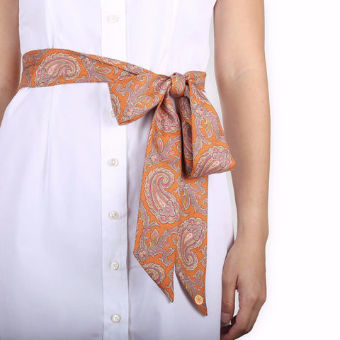 Pezuri Paisley Silk Sash in Pumpkin. Shop online orange paisley sash made from silk twill printed in Como, Italy with a soft madder finish. Designed and made in Singapore. International shipping.