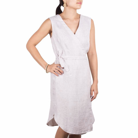 Wrap Dress in Cream Linen. Shop online sleeveless wrap dress in crisp Italian khaki-white nailhead weave linen, with self-tie at waist and flattering v front. Drapes elegantly. Made in Singapore.