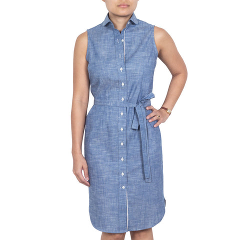 Marui Sleeveless Shirtdress in Light-Blue Chambray Cotton Selvedge. Shop online sleeveless shirtdress in Japanese light blue selvedge cotton chambray with club collar, waist darts and a removable sash. Made in Singapore. International shipping.