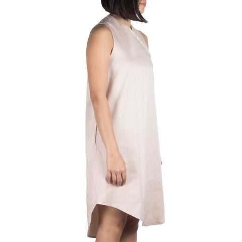 Shop online cheongsam-inspired dress with asymmetrical curved hem, made of Japanese cotton tencel in light pink. Designed and made in Singapore. International shipping.