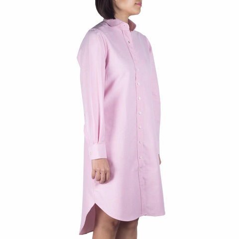 Marui Sleeved Shirtdress in Pink Cotton Oxford Selvedge. Shop online sleeved shirtdress in Japanese pink cotton oxford selvedge with club collar, relaxed fit and two pockets. Made in Singapore. International shipping.