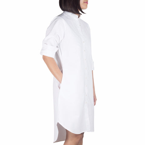 Bando Sleeved Shirtdress in White Cotton Oxford Selvedge. Shop online sleeved shirtdress in Japanese white cotton oxford selvedge with band collar, relaxed fit. Designed and made in Singapore. International shipping.