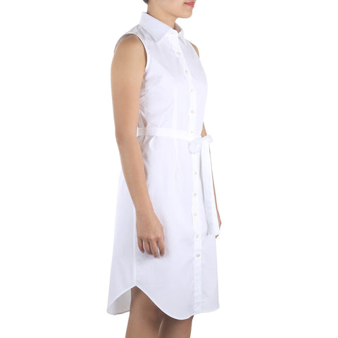 Shop online sleeveless shirtdress in white cotton poplin with point collar, waist darts and a removable sash. Made in Singapore. International shipping.