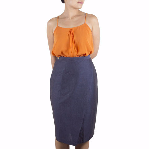 Shop online wrap skirt with pencil-skirt silhouette, cut from Italian cotton linen in a denim blue hue. Designed & made in Singapore. International shipping.