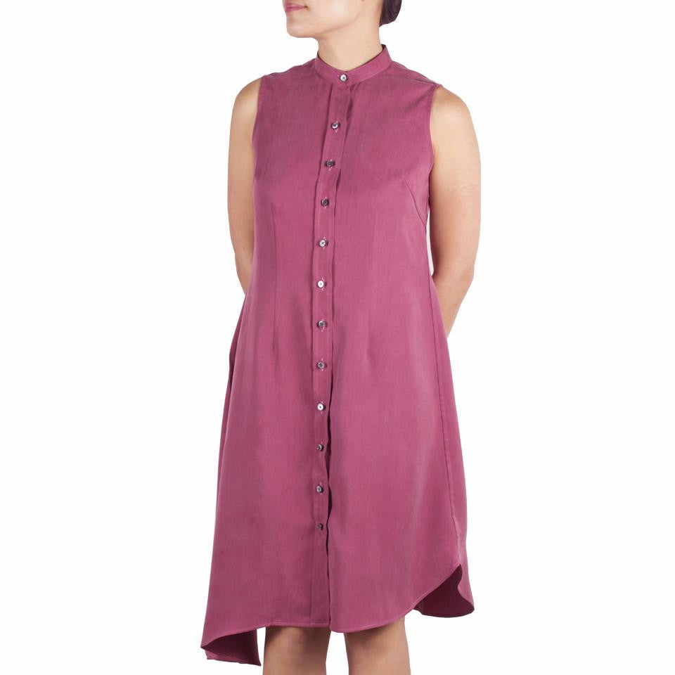 Bando Side Drape Shirtdress in Cerise Tencel. Shop online sleeveless shirtdress in Japanese pink tencel with band collar, asymmetrical hem and waist darts. Designed and made in Singapore. International shipping.
