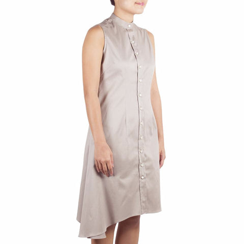 Bando Side Drape Shirtdress in Safari Cotton Tencel. Shop online sleeveless shirtdress in Japanese beige cotton tencel with band collar, asymmetrical hem and waist darts. Designed and made in Singapore. International shipping.