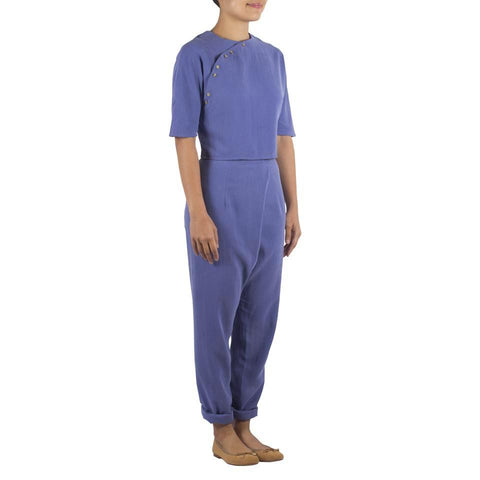 Overlap Pants in Periwinkle Blue Tencel Cotton. Shop online pleated tapered pants made from Japanese tencel cotton, with horn buttons. Made in Singapore, international shipping.