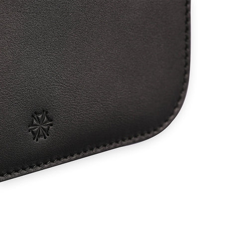 Penta Cow Leather Pouch in Noir. Shop online black pouch with wristlet strap, made of cow leather from Spain. Designed in Singapore, made in Spain. Monogram your initials to make it uniquely yours!