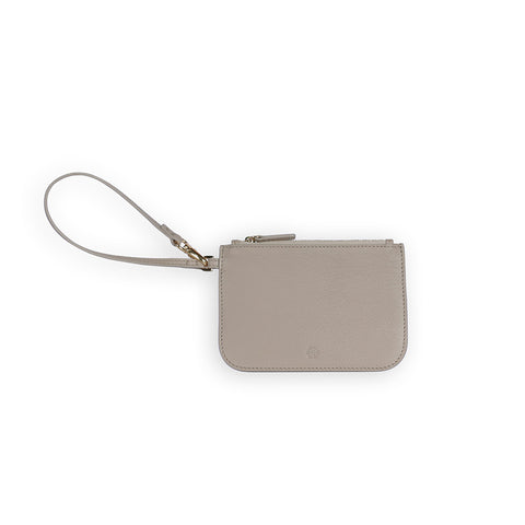 Penta Goatskin Leather Pouch in Latte. Shop online beige pouch with wristlet strap, made of goatskin leather from South of France. Designed in Singapore, made in Spain. Monogram your initials to make it uniquely yours!