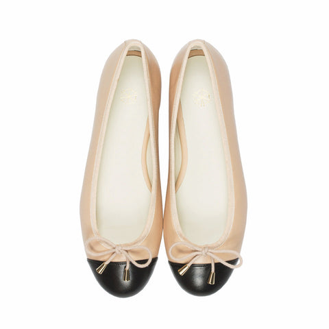 Calla Cap-Toe Ballet Flats in Black & Nude. Shop online black & cream cap-toe ballerina flats with sheepskin leather uppers, calf leather lining and cow leather outsoles. Designed in Singapore and made in Spain. International shipping.