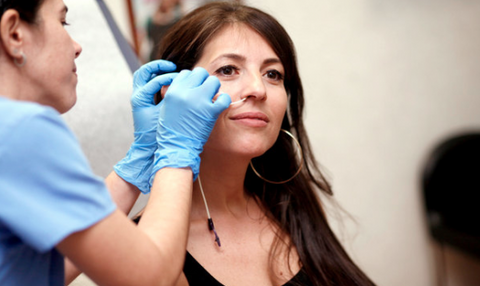 Woman with a tube attached to her nose