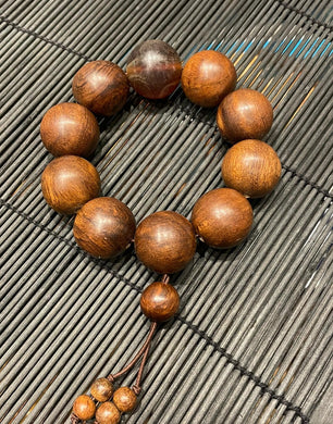 Rosewood bead bracelet with Amber