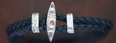 Sterling Silver Kayak with Braided Leather Bracelet
