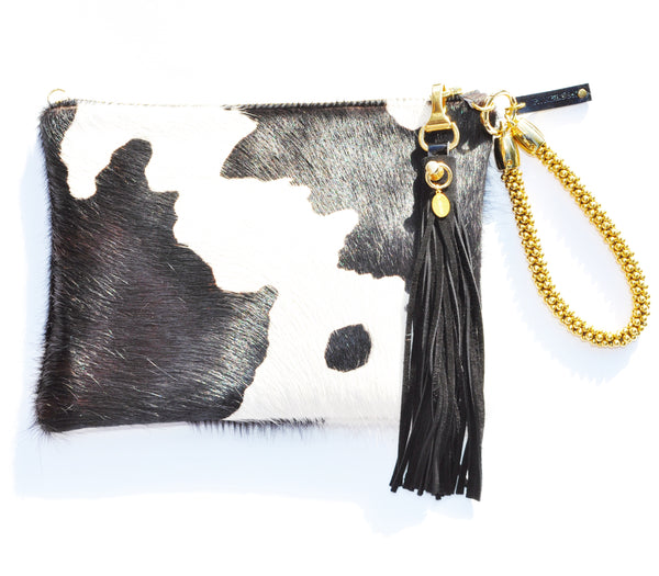 Cow clutch with suede flogger tassel