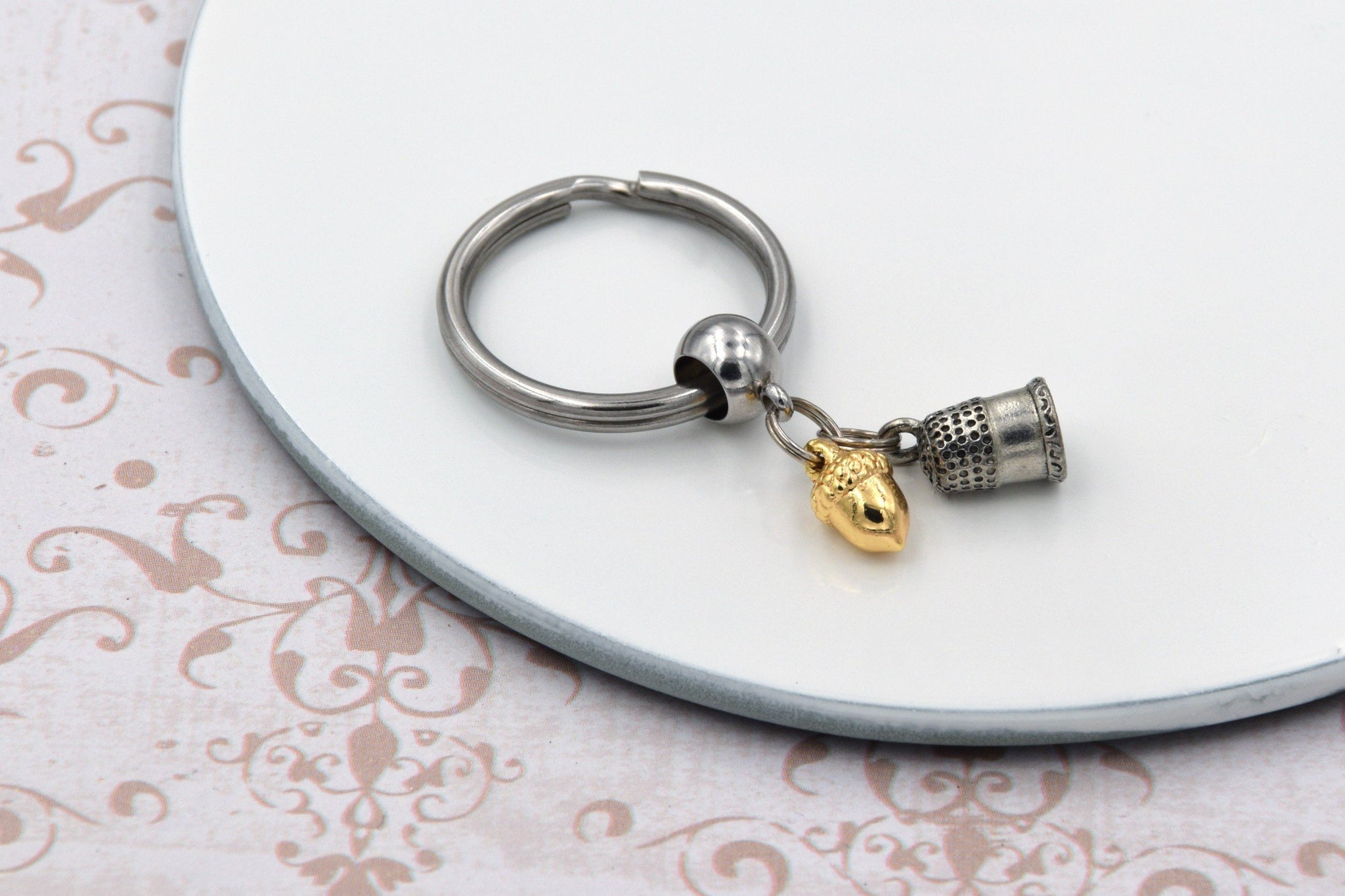 Peter Pan Kiss Keychain with Thimble and Acorn Charms fripparie