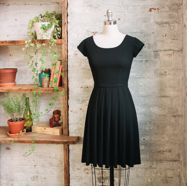 Knee Length Black Pleated Dress with Short Sleeves by Jessica Rose