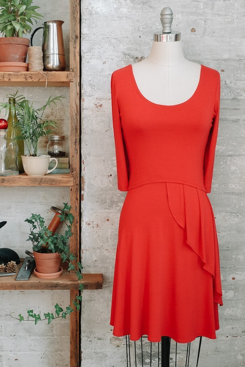 Café coral red orange pleated french style dresses with 3/4 sleeves and scoop neck in knee length