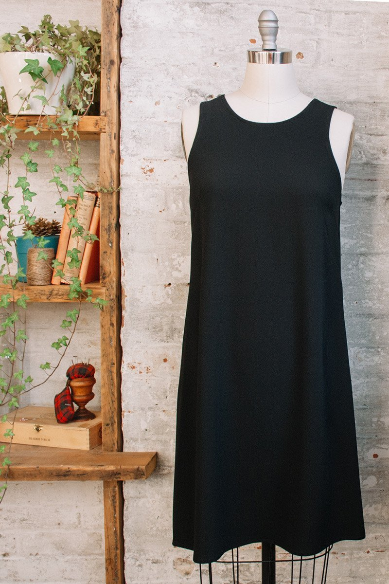 Sleeveless black a-line dress with pockets and boat neck in Triacetate
