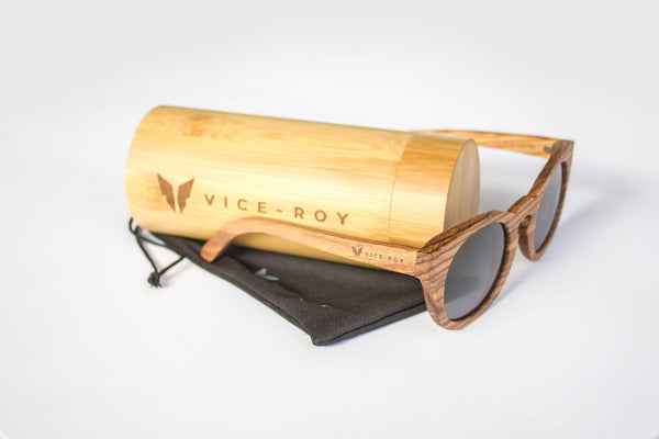 Vice-Roy Amazon Sunglasses in Zebra Wood. Black Polarized Lenses. Oblique with Bamboo Sunglasses Case.