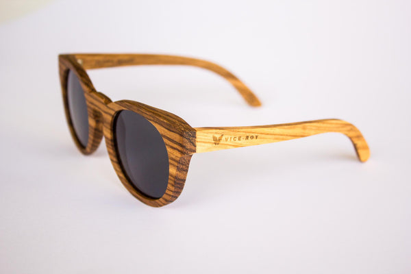 Vice-Roy Amazon Sunglasses in Zebra Wood. Black Polarized Lenses. Front Left Oblique.