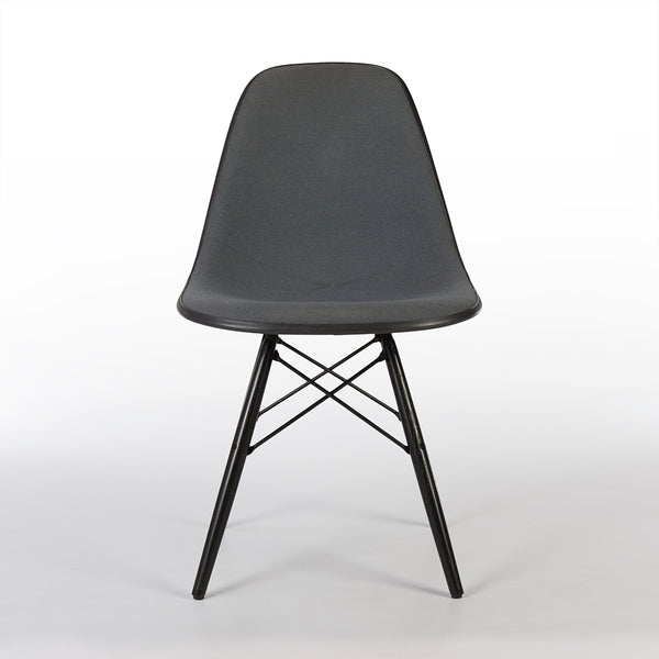 Front view of grey on black upholstered Eames DSW chair