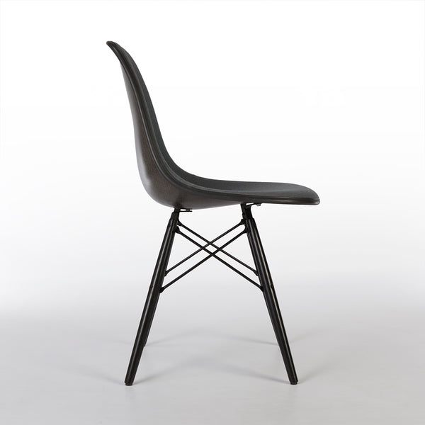 Right side view of grey on black upholstered Eames DSW chair