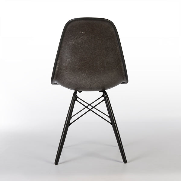 Rear view of grey on black upholstered Eames DSW chair