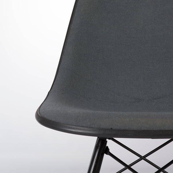 View of seat part of grey on black upholstered Eames DSW chair