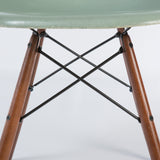 Closed up view of dowel base of Seafoam Herman Miller Vintage Eames DSW Side Shell Chair