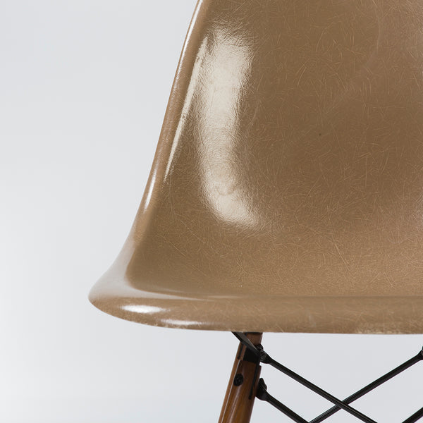 closed up view of Tan Herman Miller Original Eames DSW Dining Side Shell Chair