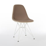 Front angled view of beige upholstered Eames DSR chair