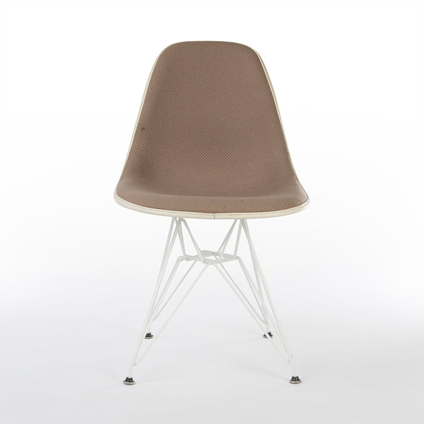 Front view of beige upholstered Eames DSR chair