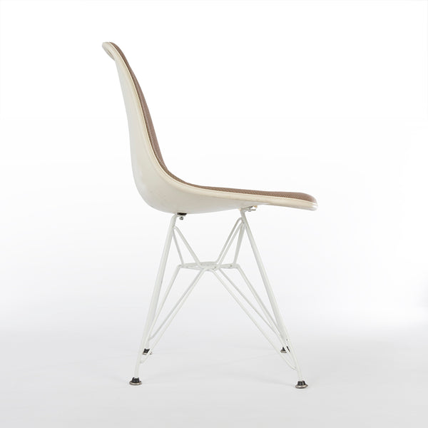 Right side view of beige upholstered Eames DSR chair
