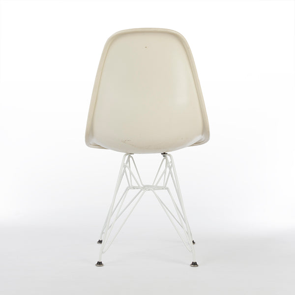 Rear view of beige upholstered Eames DSR chair