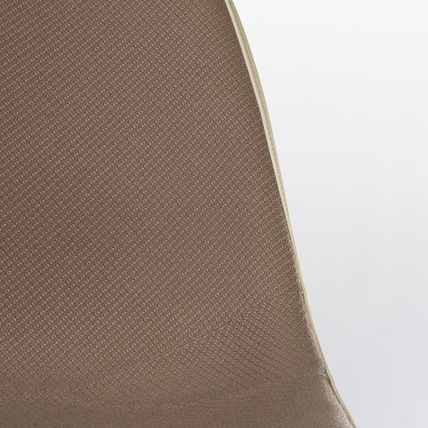 Close up view of upholstery on beige upholstered Eames DSR chair