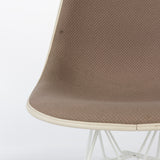 View of seat section on beige upholstered Eames DSR chair
