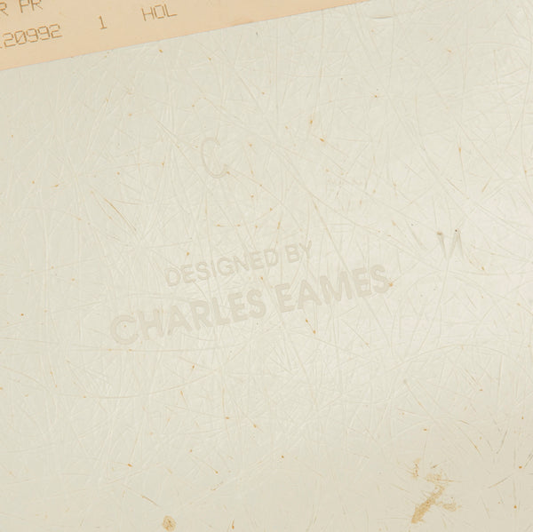Image of logo on beige upholstered Eames DSR chair