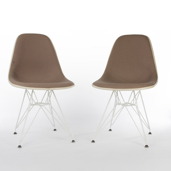 Pair of beige upholstered Eames DSR chairs at an angle