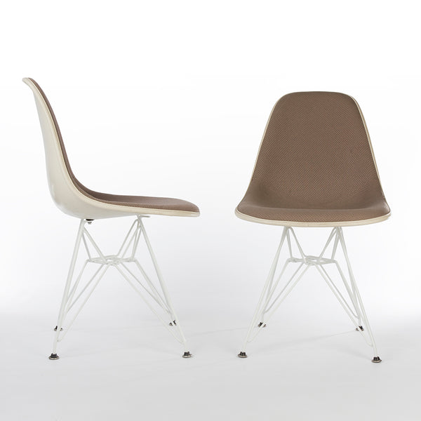 Pair of beige upholstered Eames DSR chairs one from right side, one from front