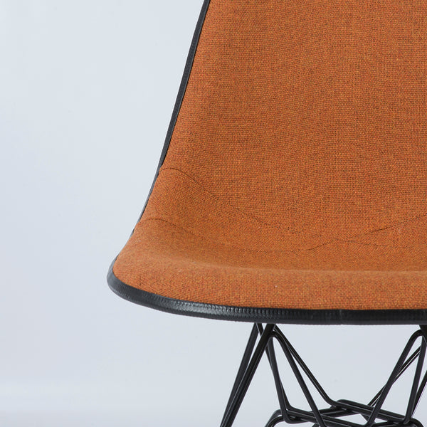 Close up view of Speckled Orange And White Herman Miller Eames Original DSR Side Shell Chair
